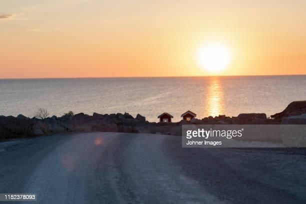 sunset at sea - エーランド ストックフォトと画像