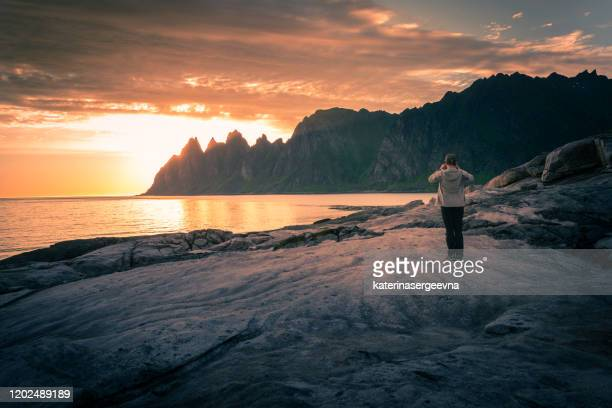 sunset at sea - rocky coastline stock pictures, royalty-free photos & images