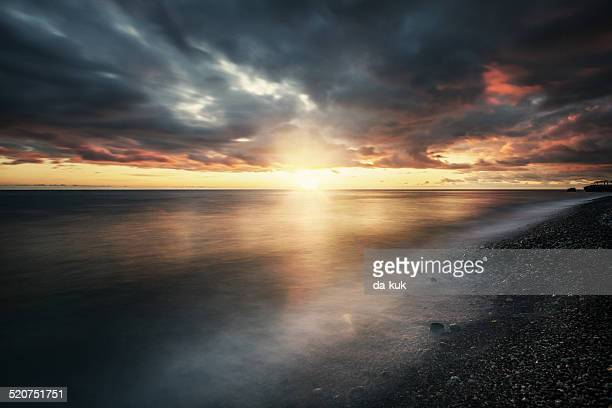 sunset at sea - moody sky stock pictures, royalty-free photos & images