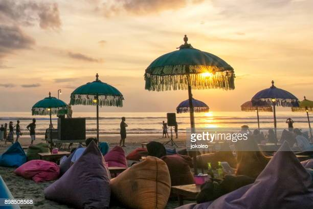 sunset at seminyak beach bali, indonesia - indonesien stock-fotos und bilder