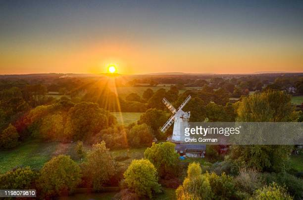 Sunset at Shipley Mill in West Sussex on October 10, 2018 in Shipley, United Kingdom. The windmill is famous for being the home of fictional...