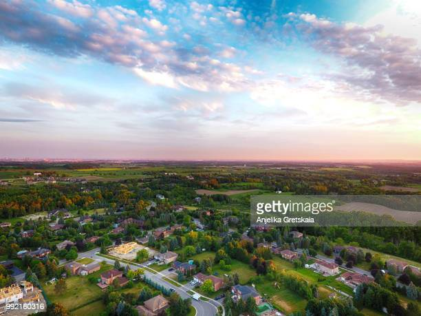 Sunset at small town on aerial view in summer, Ontario, Canada