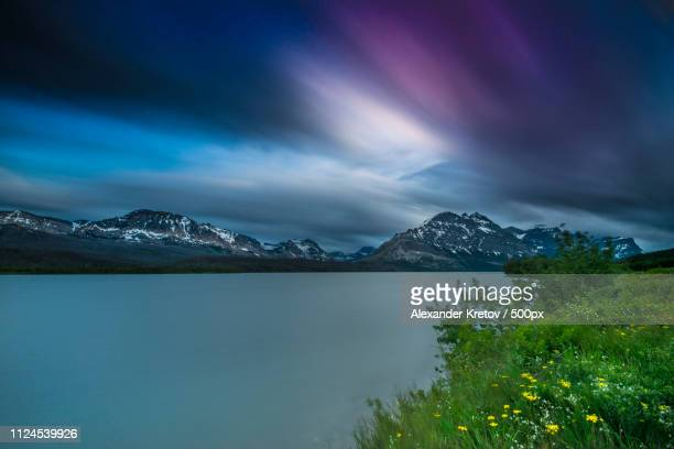 sunset at st. mary lake - mary lake stock photos and pictures
