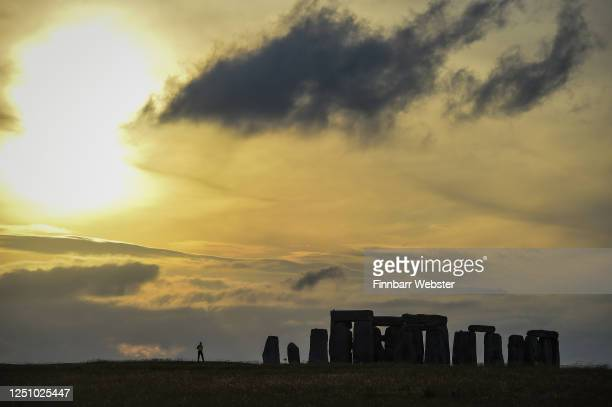 Sunset at Stonehenge ahead of Summer Solstice on June 20, 2020 in Amesbury, United Kingdom. English Heritage, which manages the site, said 'Our...