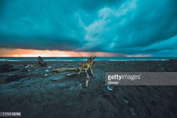 sunset at sunset point, hokitika - extreme weather stock pictures, royalty-free photos & images