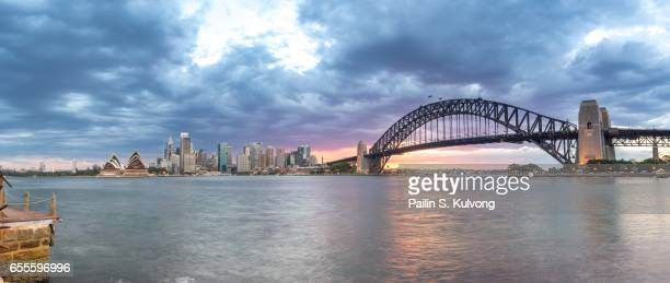 sunset at sydney opera house and harbour bridge, new south wales, australia - darling harbour stock pictures, royalty-free photos & images