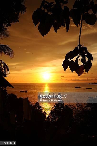 Sunset at Teluk Bayur, Padang, West Sumatra, Indonesia views from the Bukit Lampu Hill. Enchanting beauty of sunset in Teluk Bayur port very...