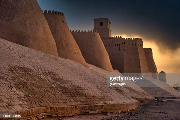 sunset at the ancient city walls of khiva, silk road, uzbekistan - uzbekistan stock pictures, royalty-free photos & images