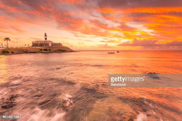 Sunset at the Barra's Lighthouse and beach in Salvador, Bahia.