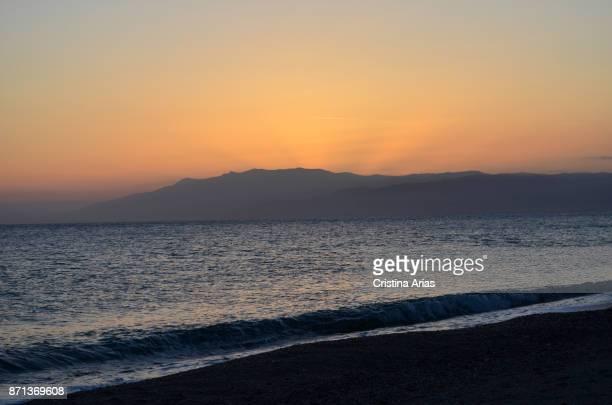 Sunset at the beach in La Almadraba de Monteleva small fishing village in Cabo de Gata in May 2017 Almeria Andalucia Spain