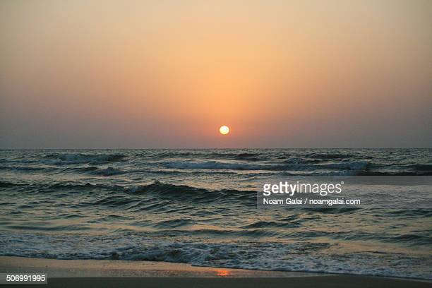 sunset at the beach - noam galai stock pictures, royalty-free photos & images