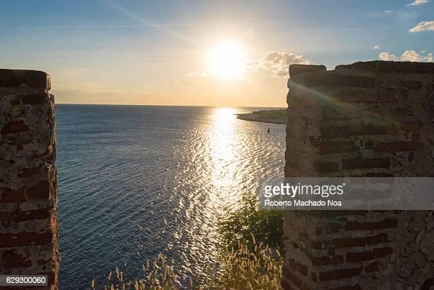 Sunset at the Castillo de San Pedro de la Roca or El Morro de Santiago de Cuba The fortress was declared a World Heritage Site by UNESCO in 1997...