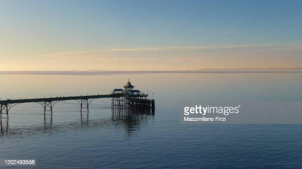 sunset at the clevedon pier - clevedon pier stock pictures, royalty-free photos & images