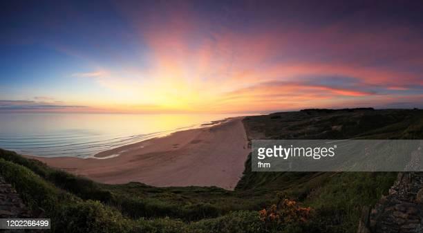 sunset at the coastline (normandy, france) - cotentin photos et images de collection
