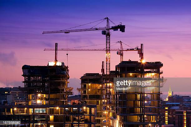 sunset at the construction site - crane stock pictures, royalty-free photos & images