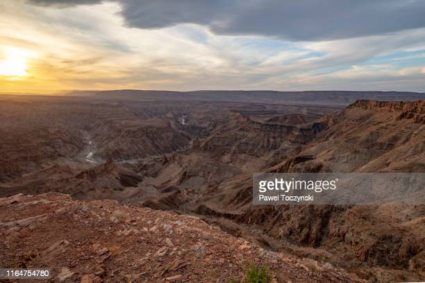 sunset at the fish river canyon in southern namibia, africa, 2018 - 荒野 ストックフォトと画像