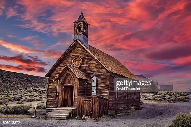sunset at the ghost town - methodist church imagens e fotografias de stock