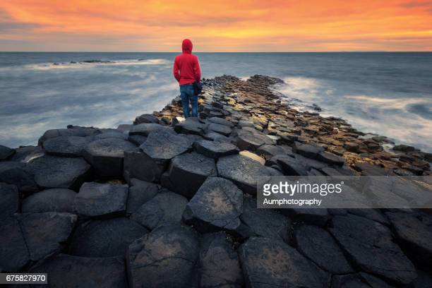 sunset at the giants causeway in northern ireland. - county antrim stock pictures, royalty-free photos & images