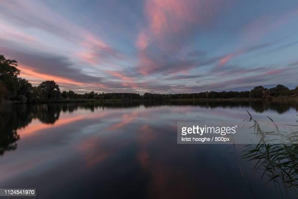 sunset at the lake bergelen - zonsondergang stock pictures, royalty-free photos & images