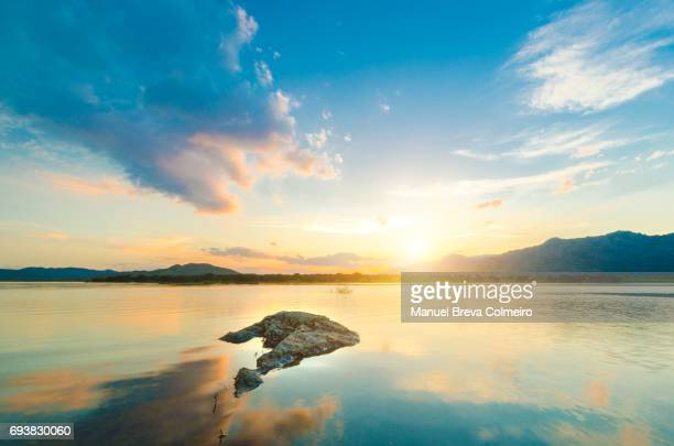 sunset at the lake - brightly lit stock pictures, royalty-free photos & images