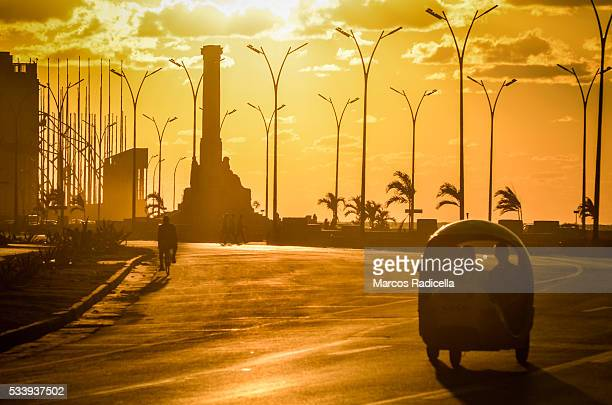 sunset at the malecón, havana, cuba. - radicella stock pictures, royalty-free photos & images