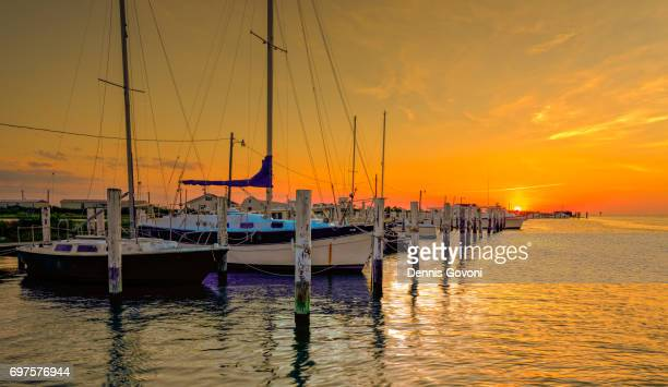 sunset at the marina - chesapeake bay stock pictures, royalty-free photos & images