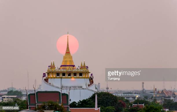 Sunset at the middle of the temple The Golden Mount. Travel Landmark of Bangkok ,Thailand.