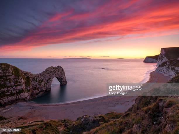 Sunset at the natural rock arch of Durdle Door.
