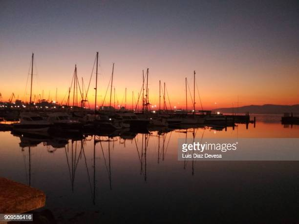 sunset at the port of the yachts