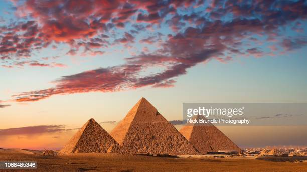 sunset at the pyramids, giza, cairo, egypt - cairo stock pictures, royalty-free photos & images