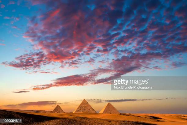 sunset at the pyramids, giza, cairo, egypt - pyramid shape stock pictures, royalty-free photos & images