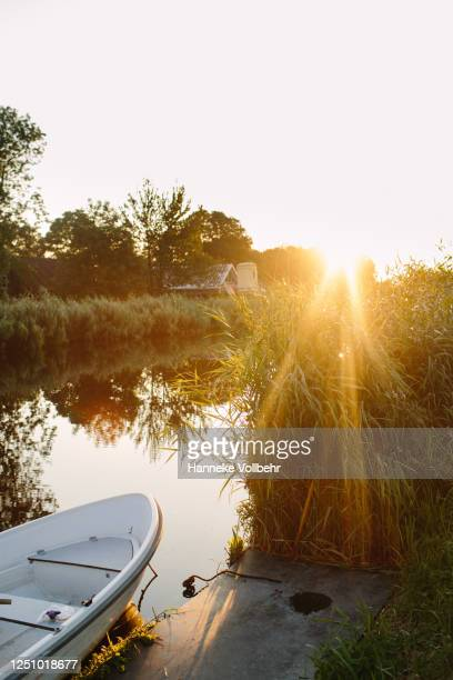 sunset at the river - kamperen stock pictures, royalty-free photos & images