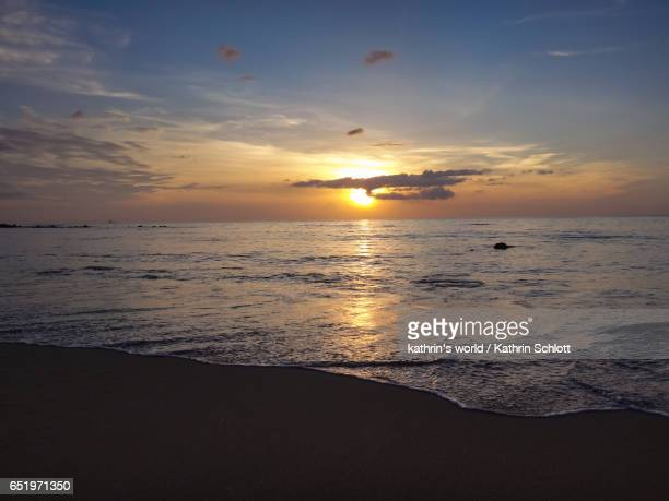 sunset at the sea - beschaulichkeit stock pictures, royalty-free photos & images
