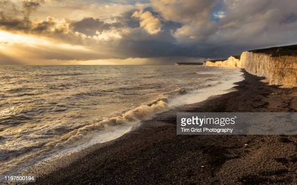 sunset at the seven sisters cliffs, east sussex, uk - tim grist stock pictures, royalty-free photos & images