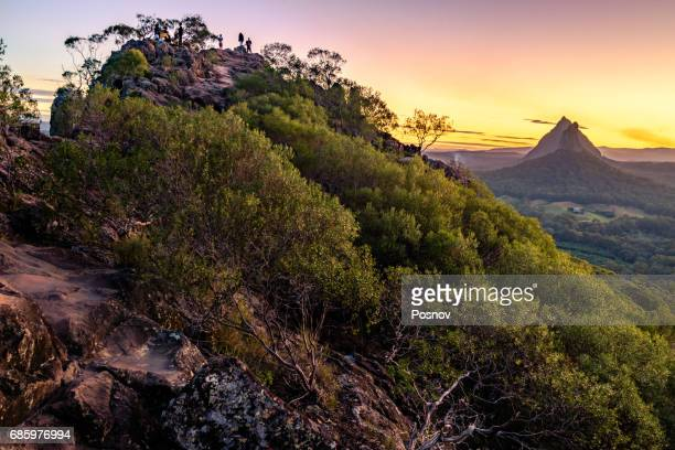 sunset at the top of mt ngungun - glass house mountains stock pictures, royalty-free photos & images