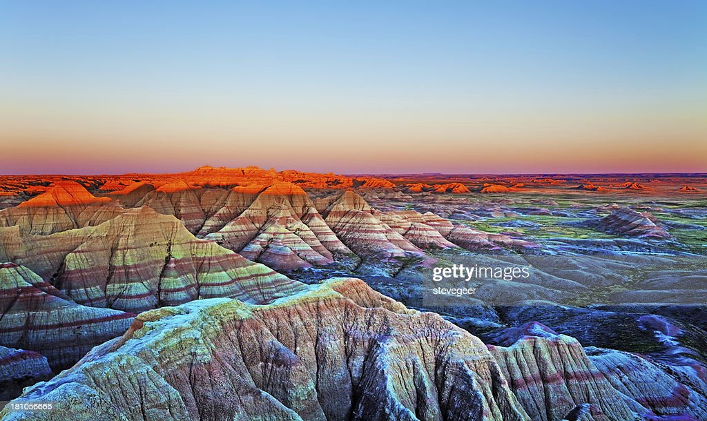 Pôr do sol na parede, Parque Nacional de Badlands, Dakota do Sul. : Foto de stock