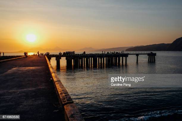 sunset at the wharf in ende. - caroline pang stock pictures, royalty-free photos & images