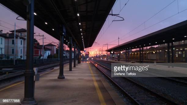 sunset at train station - 鉄道のプラットホーム ストックフォトと画像