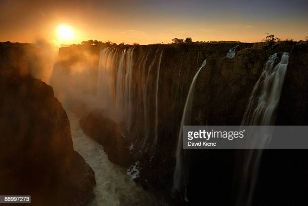 sunset at victoria falls, zambia - victoria falls stock pictures, royalty-free photos & images