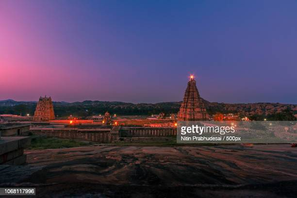 sunset at virupaksha temple, hampi, karnataka, india - karnataka stock pictures, royalty-free photos & images