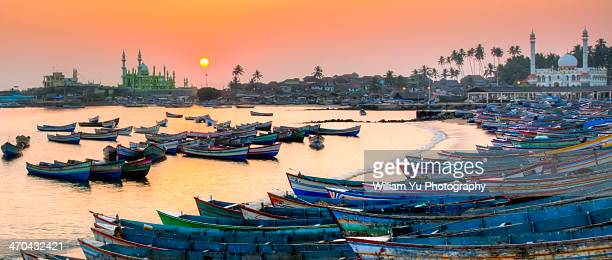 sunset at vizhinjam fishing harbor, india - kerala stock pictures, royalty-free photos & images