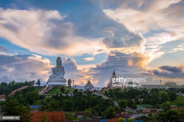 sunset at wat huay pla kang temple (chinese temple) chiang rai, thailand - guanyin bodhisattva stock pictures, royalty-free photos & images
