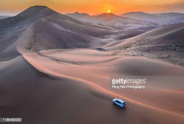 sunset @ badain jaran desert, inner mongolia, china - 内モンゴル自治区 ストックフォトと画像
