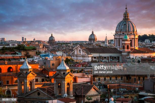 sunset, basilica of ss ambrose and charles on the corso, rome, italy - rome italy stock pictures, royalty-free photos & images