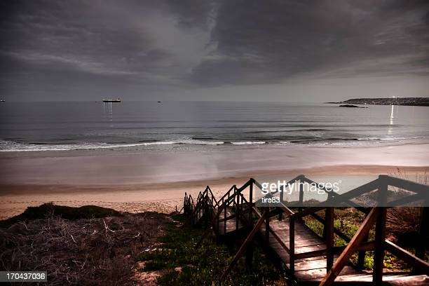 sunset beach and bay scene wooden steps - mossel bay stock pictures, royalty-free photos & images