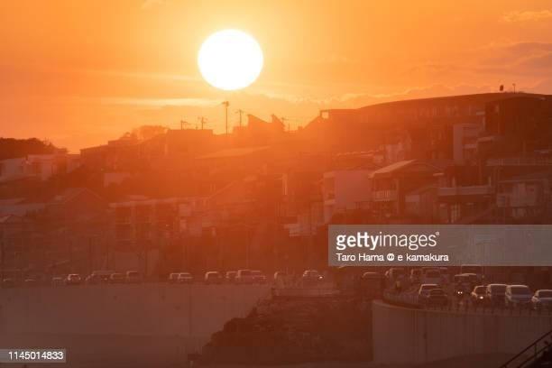 sunset beach and road in japan - image title stock pictures, royalty-free photos & images