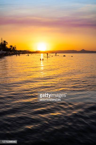 sunset beach in alicante at denia marinas beach of spain - denia stock pictures, royalty-free photos & images