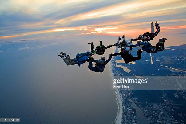 "Sunset beach load over the Emerald Coast of Lower Alabama . Seven jumpers have formed what we call a BFR - Big ""Fun"" Round - over the coastline. This..."