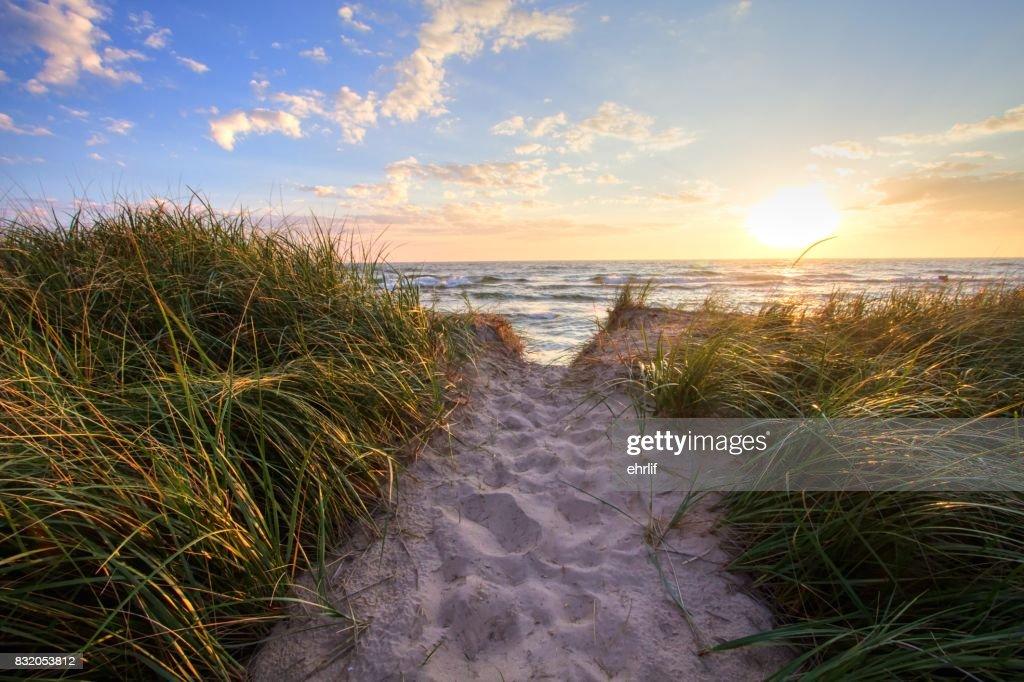 Sunset beach path panoramic background stock photo getty images sunset beach path panoramic background stock photo voltagebd Images