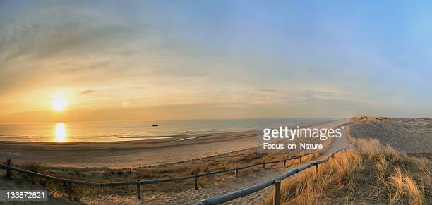 sunset beach - north holland stock pictures, royalty-free photos & images